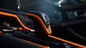 Чёрно-оранжевый салон Порше Панамера от ТечАрт