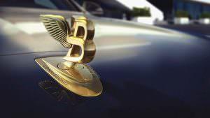 Золотая эмблема Bentley