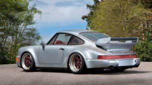 Фото   Серебристый металлик Porsche 911 RSR 1993 года