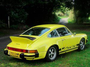 Жёлтая Porsche 911 Carrera 2.7 MFI 1974 года